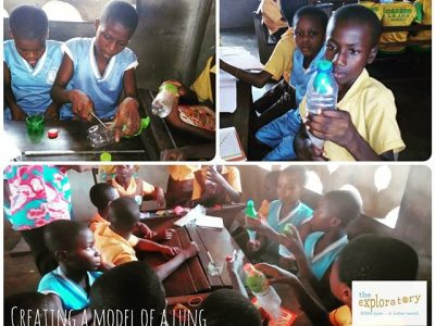 students in ghana creating bottle-balloon models of lungs