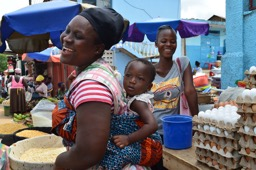 Ghanaian woman with baby strapped to her back